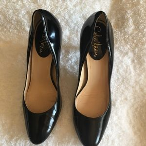 Cole Haan black heels Nike air.